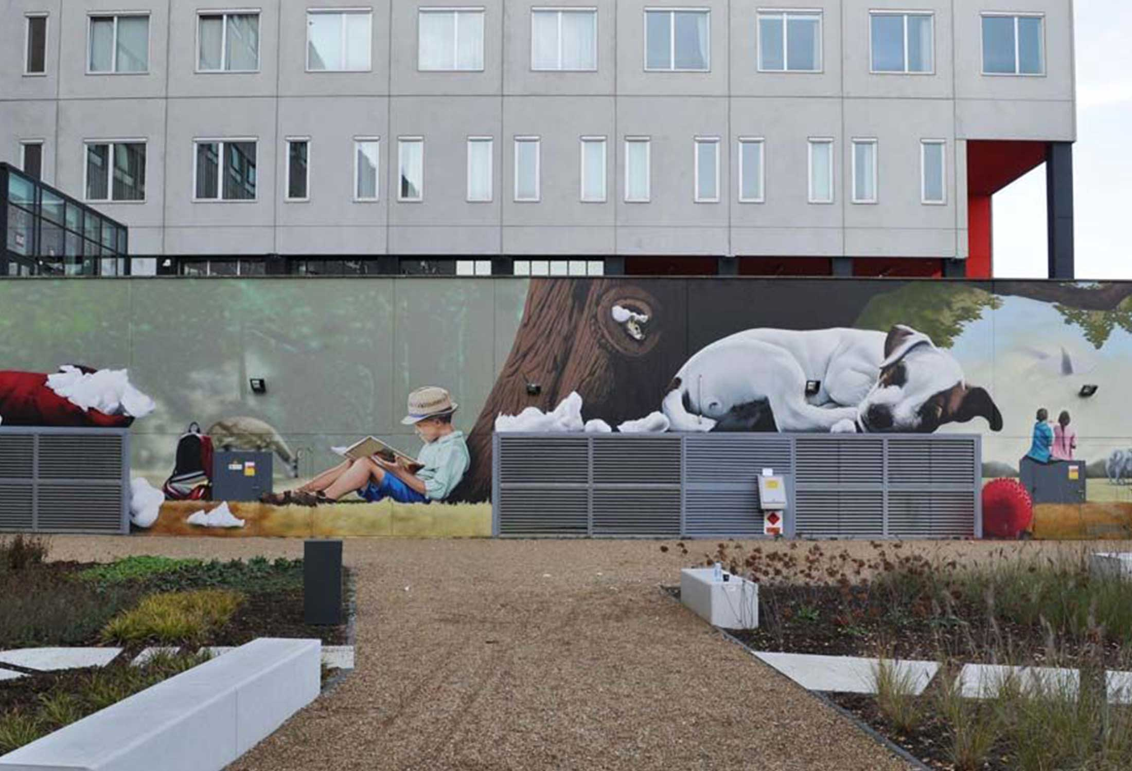 Bart Smeets used the magic of art in public places to transform an office space outdoor area into a relaxing retreat with a beautiful mural that boosts the value of the rental property