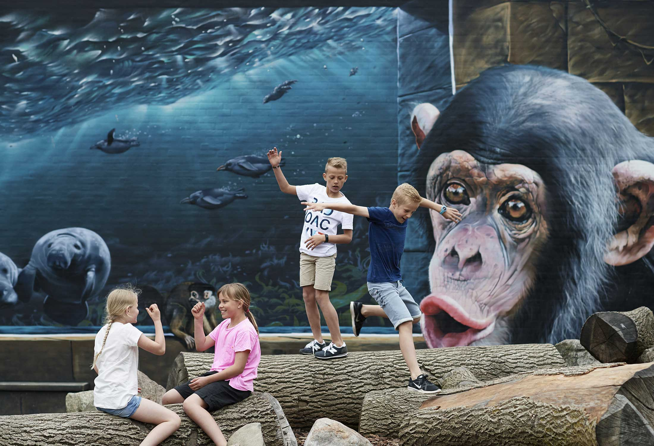 A magical and memorable mural by Tasso at Odense Zoo in Denmark that shows several animals.