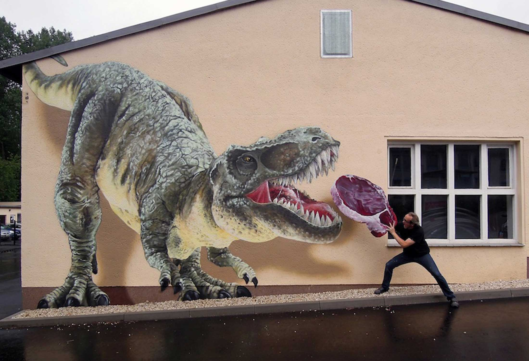 A memorable and magically-realistic mural by Tasso, TASSOsaurus Rex evokes feelings of awe and fear in viewers.
