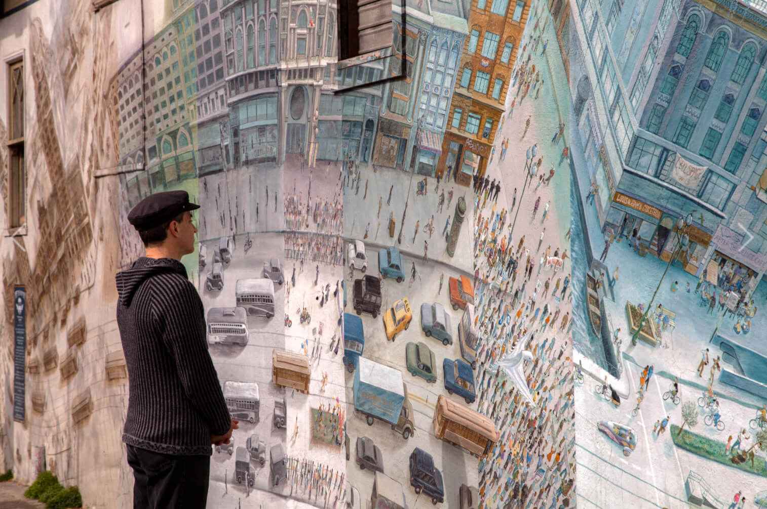 A viewer analyzing Mona Caron's Market Street Railway mural