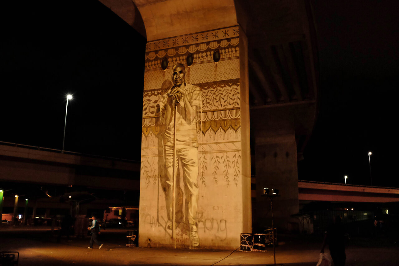 View of a single portrait mural during the night